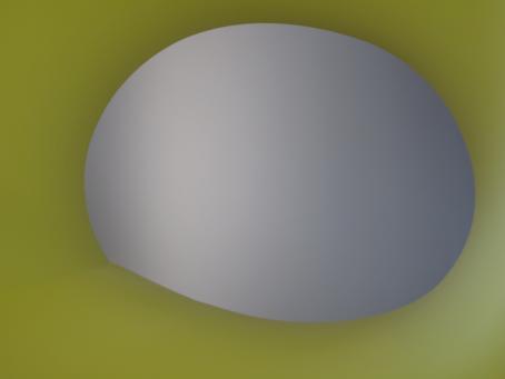 Keltavihreää taustaa vasten harmaansävyinen epätäydellisen muotoinen ympyrä.